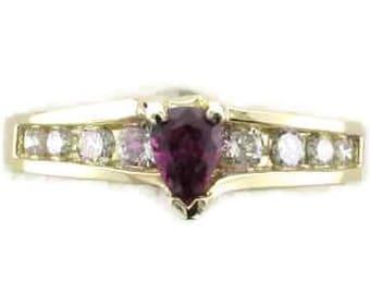 Stunning 14 Karat Yellow Gold Pear Shape Ruby and Diamond Ring