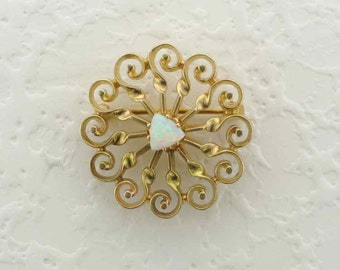 Sunburst Pin/Pendant Set with a Cabochon Cut Triangle Shaped Opal Set in 14 Karat Yellow Gold
