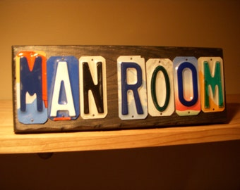 Man Room sign made with recycled license plates.