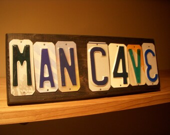 MAN CAVE sign made with recycled license plates.