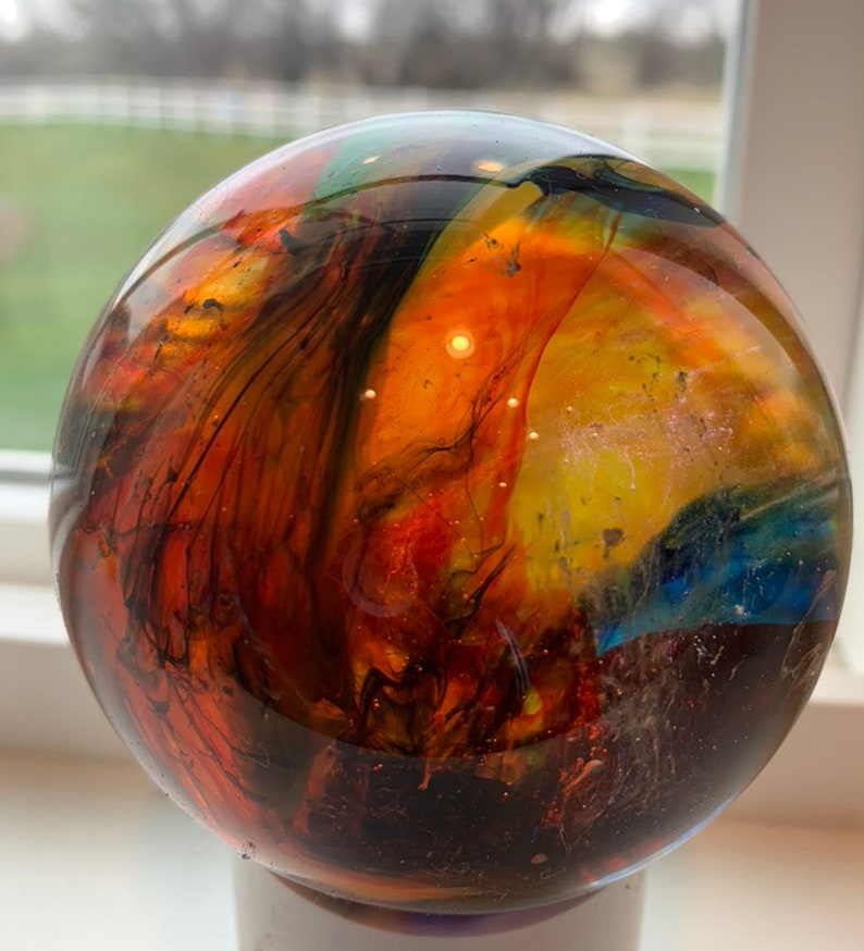 Cast Resin Sphere on wooden stand XLI image 0