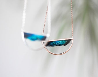Turquoise feather necklace. half circle peacock terrarium jewelry. Wave
