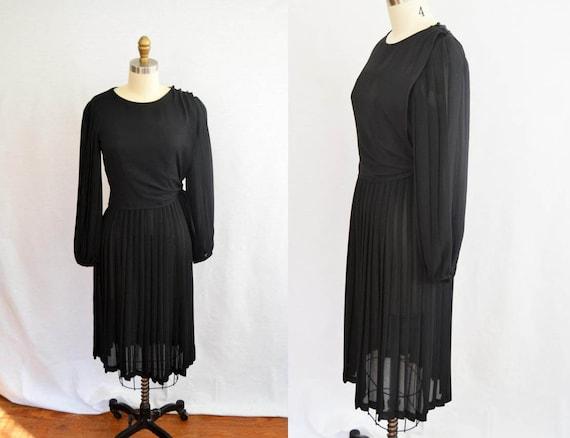 b5d5fc986ed15 Vintage 1970s black long sleeved silky wrap dress / Medium | Etsy