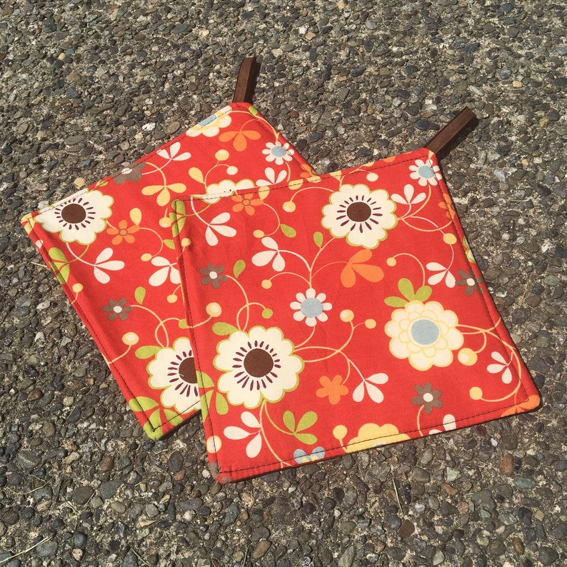 Two Pot Holders  Moda Flowers on Orange Red with Loops image 0