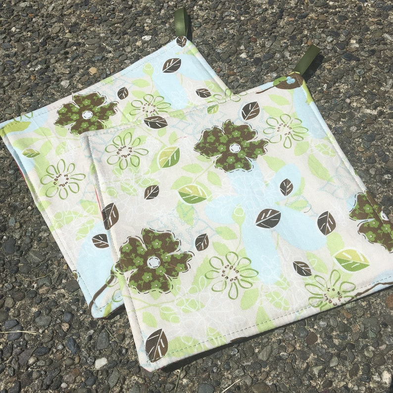 Two Pot Holders  Green and Blue Flowers on Pastel with image 0