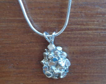 Sterling silver pendant with chain.