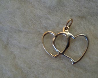 Two tone gold, hearts pendant.