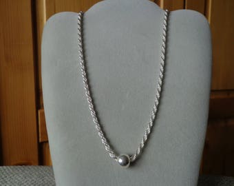 Silver bead, on silver French rope chain.