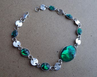 Silver (.925) bracelet with green Paua shells.