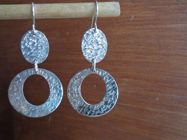 Dangling .925 silver earrings.