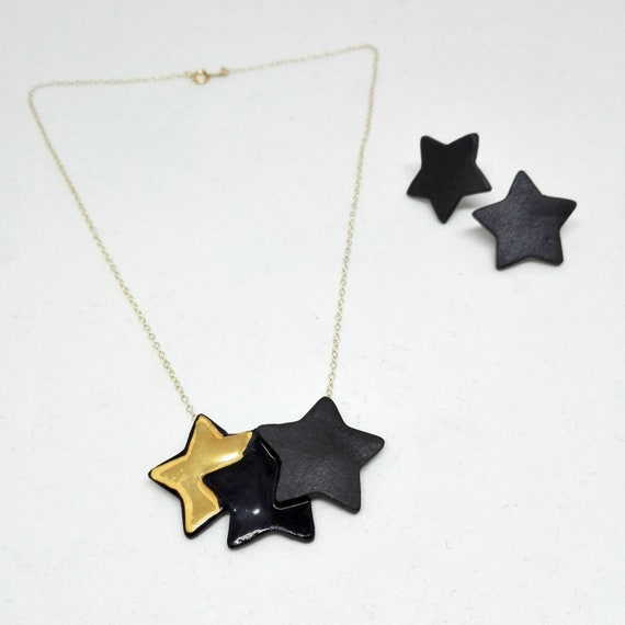 Black Stars necklace with a gold star