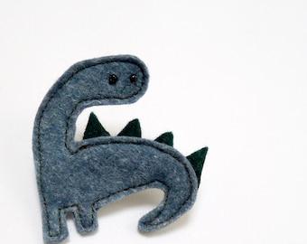 green felt dinosaur brooch