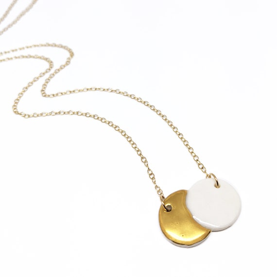 Eclipse necklace , porcelain and gold