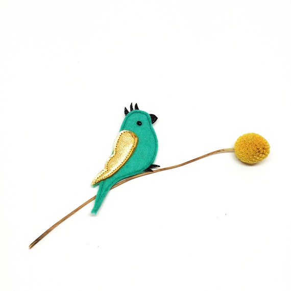 Green parakeet brooch