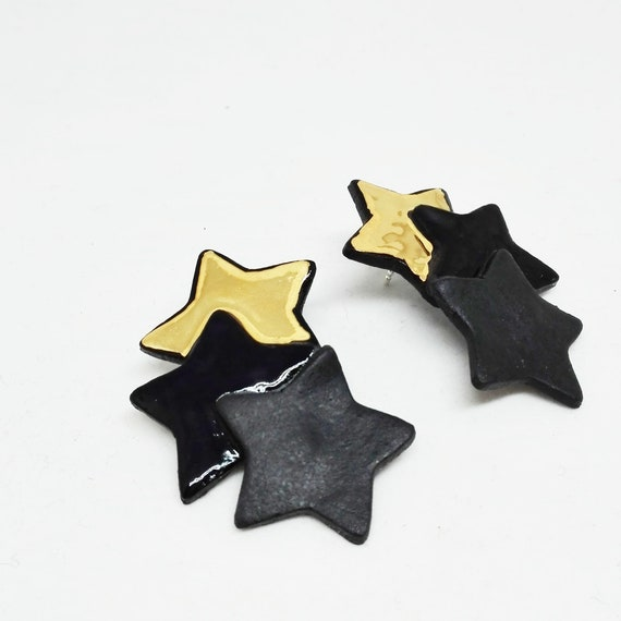 Triple Stars black and gold big earrings