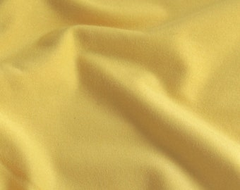 soft knit apparel fabric Yellow bamboo knit jersey spandex fabric fluid and opaque ivory leightweight knit 70/% 4-way stretch