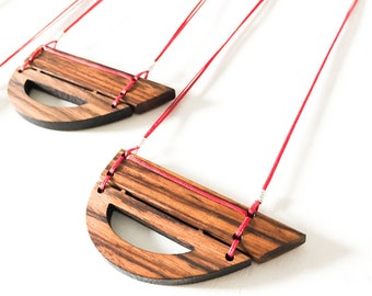 Geometric minimal wood necklace with rosewood pendant and red string