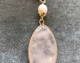 Pink quartz pendant on gold chain