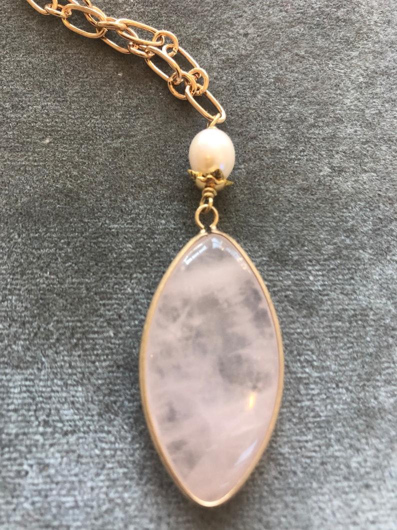 Pink quartz pendant on gold chain image 0