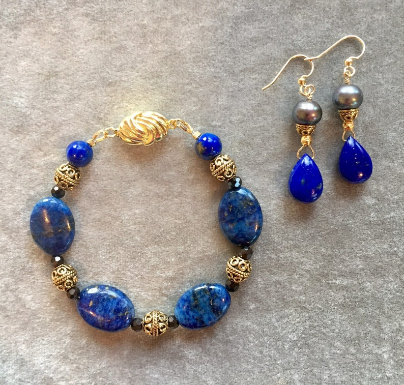 Gold and lapis bracelet earring set image 0