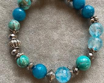 Deep blue agates, light blue crystals, dark silver stretch bracelet