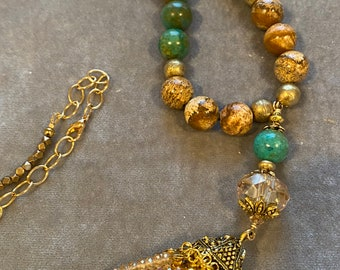 Long golden crystal tassel necklace with turquoise magnesite accents and leopard jasper stone