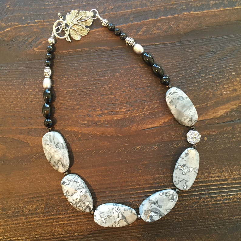 Grey jasper stone with silver Druzy accent and black onyx image 0