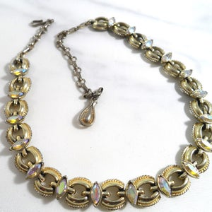 Vintage Coro Bracelet Multi strand Gold tone clasp. Aurora Borealis beaing with bronze bead accent