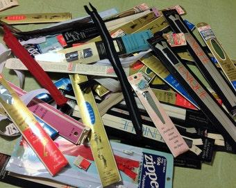 Around 4 dozen vintage zippers.