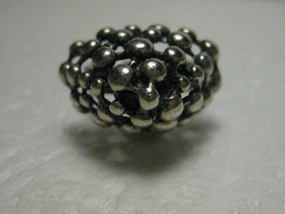 Vintage 1970's Silvertone Ball Pyramid High Set Ring, adjustable to size 8.