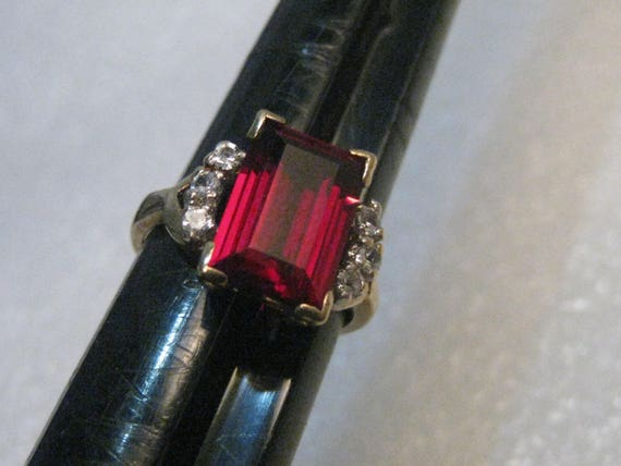 10kt Lab Created Emerald Cut Ruby & Clear Spinel Ring, Sz. 5, 4 ctw, 3.96 grams, sign