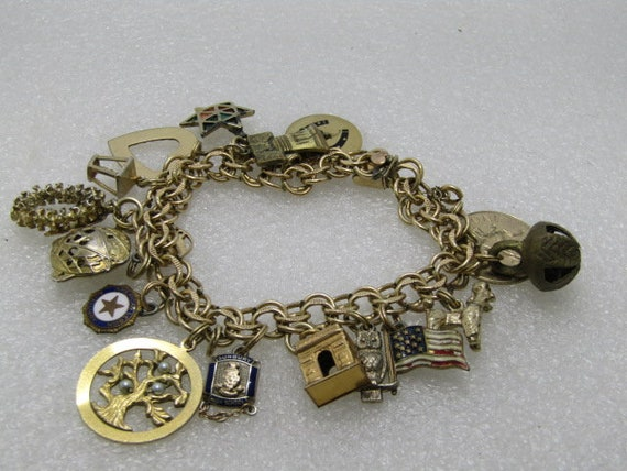 "Vintage 12kt G.F. Elco Charm Bracelet, 10kt too, 17 Charms, 10kt Gold with diamond, Sterling and G.F., 7"", 51.09 gr."