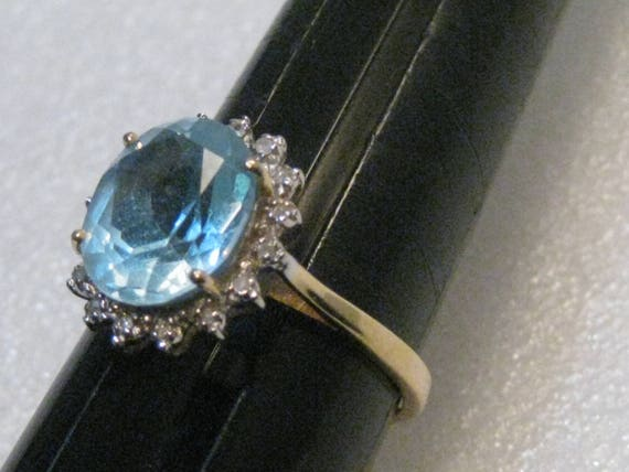 14kt Two-Tone Gold Blue Halo Topaz and Diamond Ring, 5+ TWC, size 10.5, 4.71 grams