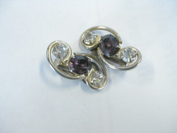 Vintage Mid-Century Goldtone Scrolled Clip Earrings with Clear and Amethyst Colored Glass Cut Stones