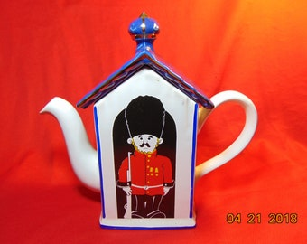 One (1), 4 Cup, Teapot, from Price Kensington, of England.