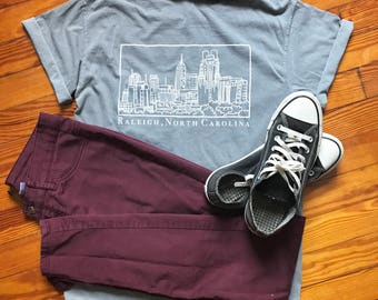 Raleigh North Carolina Skyline Illustration Screen Print on Unisex Adult Pocket 100% Cotton Comfort Colors T-Shirt
