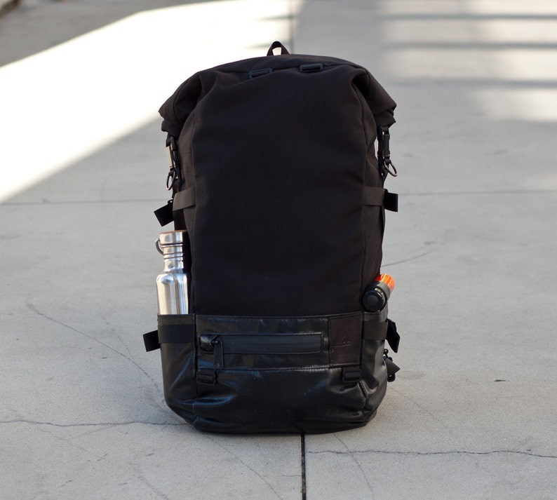 8843ea399e08 Roll Top Backpack commuter black cordura truck tarp