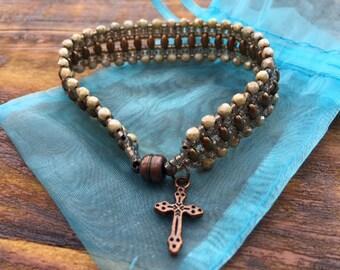 Tattered Beige Cross Charm Flat Beaded Bracelet