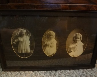 Precious blond haired girl in curls framed photos