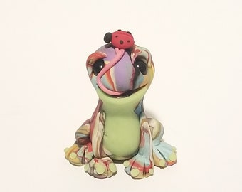 Polymer clay swirl frog with glow in the dark belly