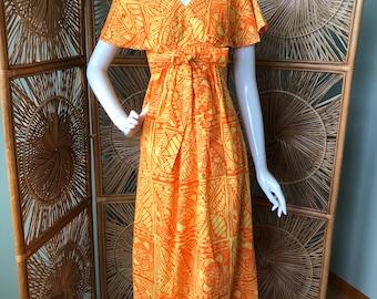 Absolutely adorable maxi dress / mu'u mu'u.  So bright-so fun!  Size small/Xsmall ( children's size )