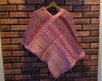 pink, burgundy, and mauve ladies or teenagers poncho