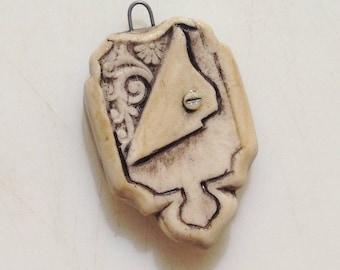 Secret Locket, handmade porcelain ceramic pendant