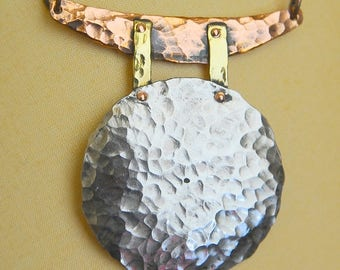 A Unique Handhammered German Silver Moon Pendant
