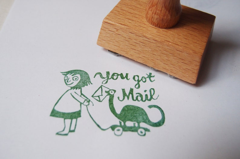 You got mail stamp girl with dinosaur