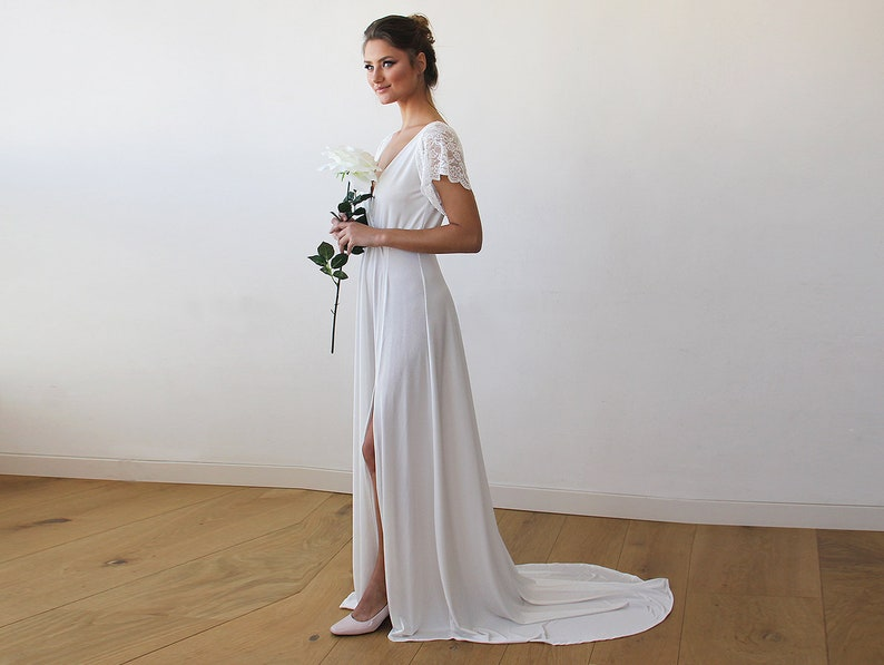 df8256544803 Ivory Wrap Wedding Gown With Short Lace Sleeves And Train 1163