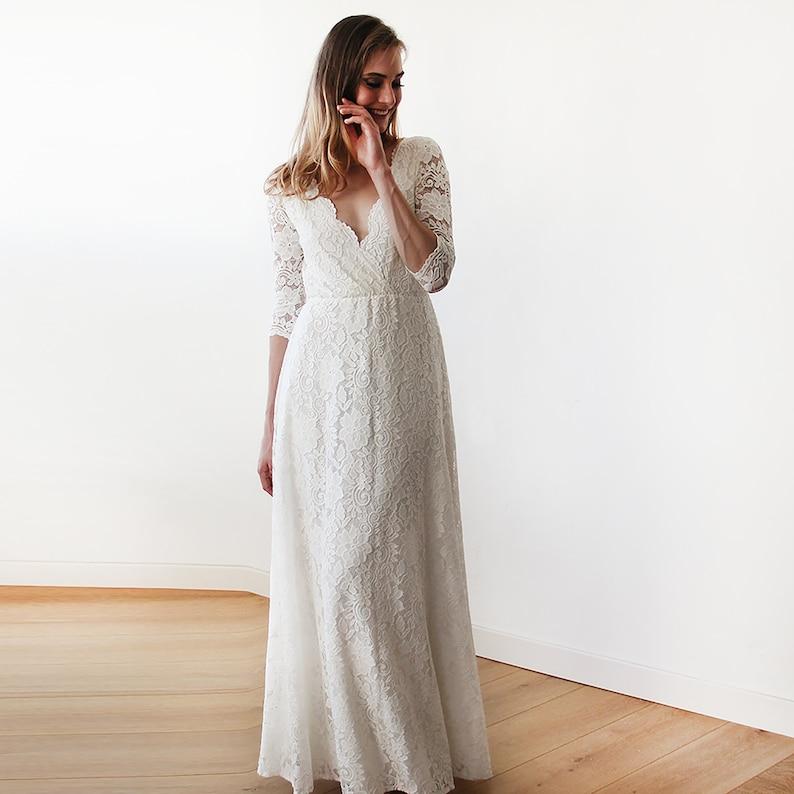 Bestseller Ivory Wrap lace maxi wedding dress 1124 image 0