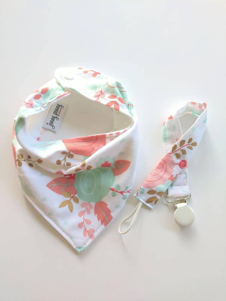 Bandana Bib and Pacifier Clip in Coral and Mint Floral. image 0