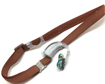 Ear Suspenders Hearing Aid Headband with adjustable head sizing, silicone grip and sliding silicone sleeves for natural BTE fit (Brown)