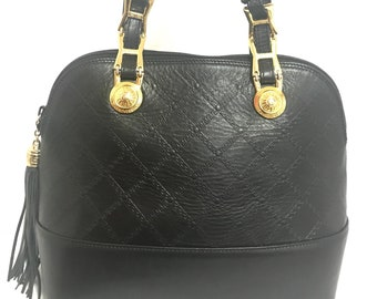 Vintage Gianni Versace black leather bolide shape handbag with a tassel and  golden sunburst charms. Lady Gaga style. 75627ca0ff7ca